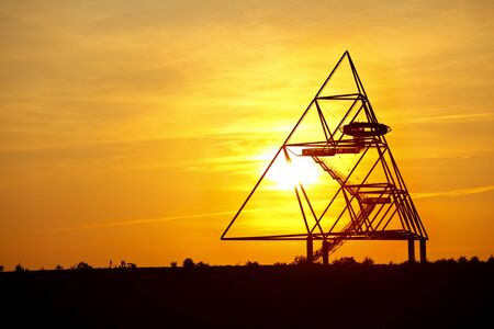 View to the famous Tetraeder in Bottrop, Germany at sunset. The Tetraeder is a more than 50m tall steel construction on top of an old slag heap.