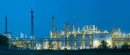 Panoramic shot of a large chemical plant with night blue sky. 写真素材