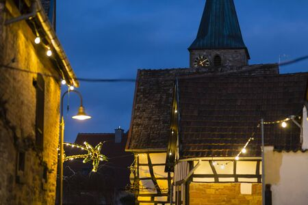 An alley with half-timbered houses and christmas lights at night in Lachen, Neustadt an der Weinstrasse, Germany. 写真素材
