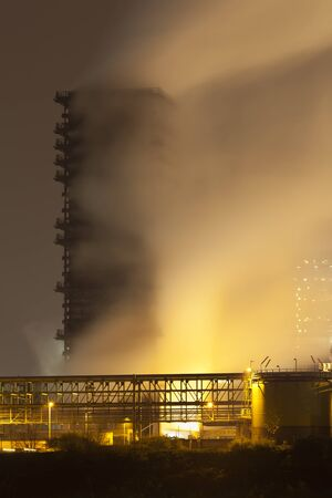 Quenching tower of a coking plant with a lot of steam.