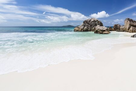The beautiful tropical beach Anse Patates in La Digue, Seychelles with clear water and granite rocks. Zdjęcie Seryjne