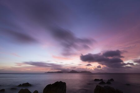 Colorful sunset long exposure shot from La Digue with view to Praslin in the Seychelles. Zdjęcie Seryjne