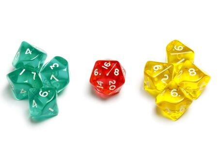 Ten sided dices (d10) and a twenty sided dice (d20) translucent in green, yellow and red. Zdjęcie Seryjne