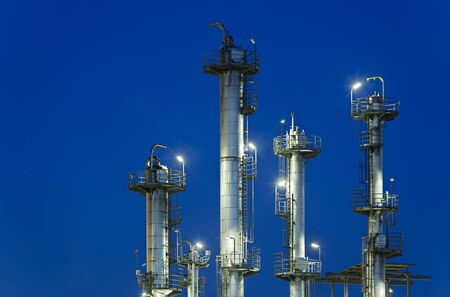 Night shot of a refinery with deep blue sky.