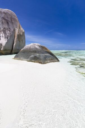 The perfect tropical beach Anse Source D'Argent in La Digue, Seychelles with clear water and scenic granite rocks. Stock Photo