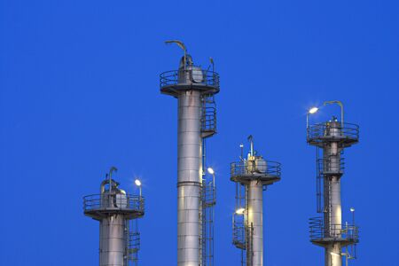 Part of a chemical plant and refinery with night-blue sky. Zdjęcie Seryjne