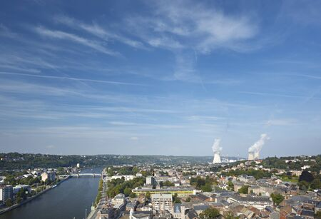 View over the city of Huy in Belgium at Meuse River to the distant nuclear power station of Tihange.