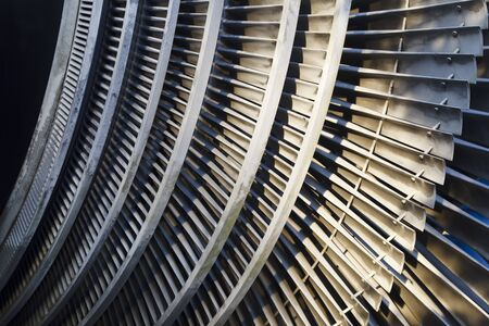Detail shot of an old power station turbine which was in use in a large nuclear power station.