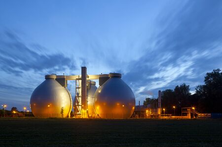 A sewage treatment plant with illumination and night blue sky. Stock Photo