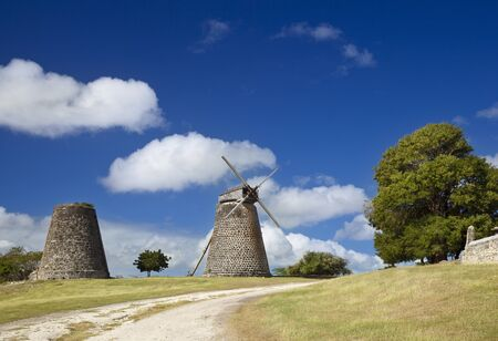 The restored sugar plantation windmills at Betty's Hope in the heart of Antigua. Stock Photo