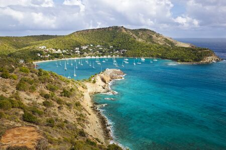 View to the beautiful bay of English Harbor in Antigua, the buildings on the top of the opposite hill are Shirley Heights.