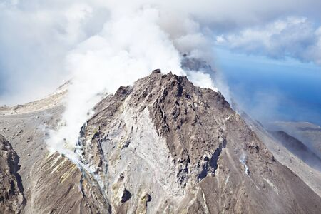 The active Soufriere Hills Volcano in Montserrat seen from helicopter. The dead landscape is frequently covered by new pyroclastic flows.