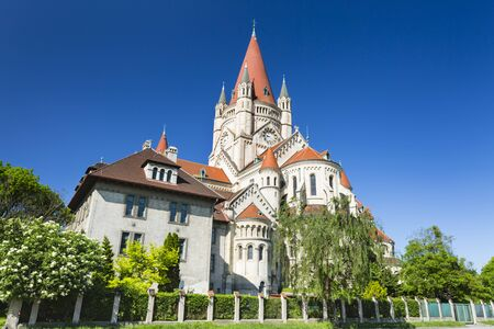 The beautiful St. Francis of Assisi Church in Vienna, Austria with deep blue sky.