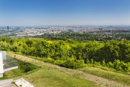 View from a hill to the city of Vienna with the Danube River (Donau) to the left in Austria.