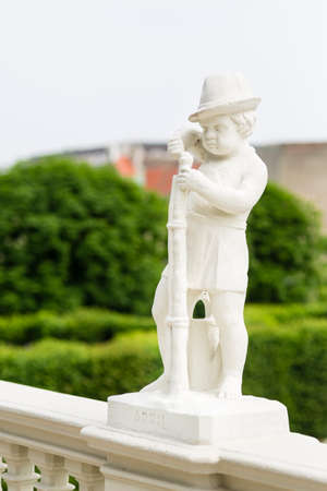 A boy statue for the month April in the Belvedere Palace park of Vienna, Austria. Editorial