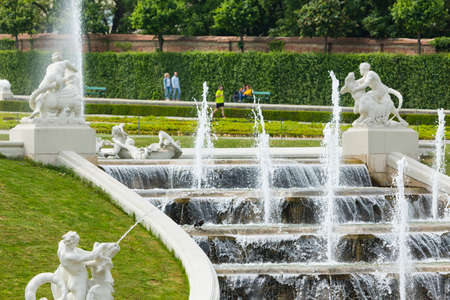 A fountain and waterfalls in the Belvedere Palace park of Vienna, Austria.
