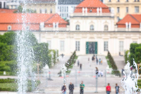 View to the Lower Belvedere in the Belvedere Palace park of Vienna, Austria with focus on a fountain in the garden. Editorial