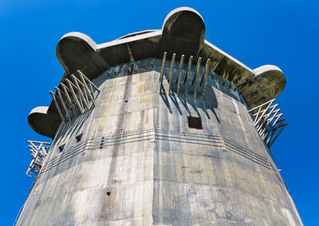 One of the famous flak towers from the second world war in the Augarten in Vienna, Austria with blue sky. Editorial