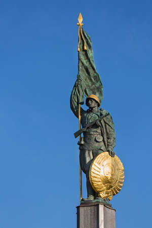 The Soviet War Memorial Statue in Vienna, Austria with blue sky.
