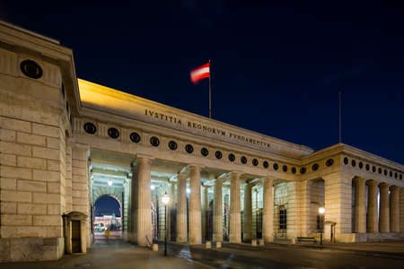 Night view of the Outer Castle Gate called Heldentor in Vienna, Austria at night.