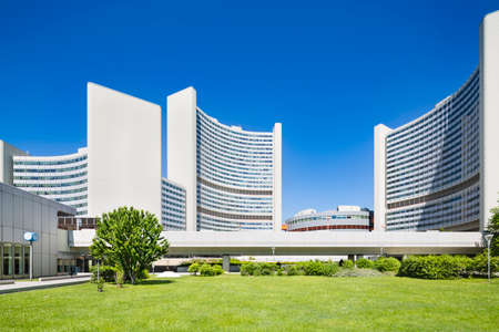 The Vienna International Centre or UNO City with green lawn and blue sky in summer.
