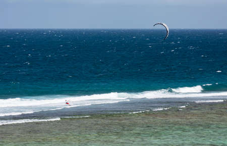 LA DIGUE - AUGUST 12: A kitesurfer in the lagoon of Anse Source D'Argent in La Digue, Seychelles on August 12, 2014 Editorial