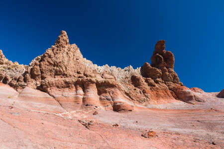 Colorful rock layers at Los Roques de Garcia In Tenerife, Spain with deep blue sky. Stock Photo