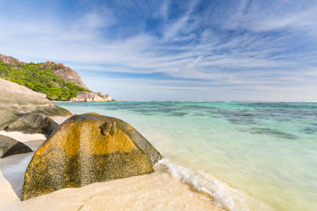 Beautiful white beach Anse Source D'Argent in La Digue, Seychelles with scenic granite rocks in the evening Stock Photo
