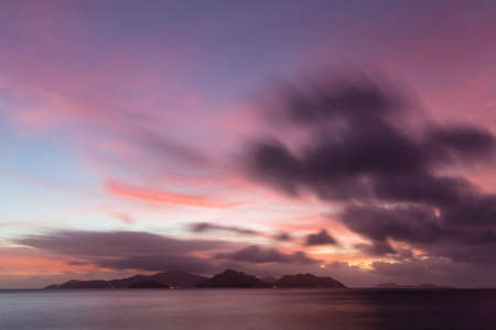 Colorful sunset view to Praslin from La Digue, Seychelles. Long exposure shot.
