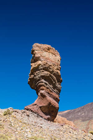 The famous Roque Cinchado in Tenerife, Spain with blue sky in the background.