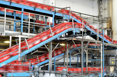 conveyor belt of a brewery - beer bottles in production and bottling Editorial