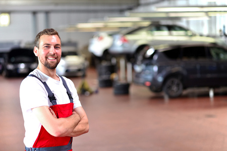 Mechanic in a car repair shop - diagnosis and troubleshooting