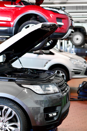 Cars for repair in a workshop Stock Photo