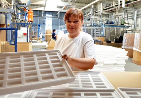 styrofoam components into packages for the customer. Stock Photo