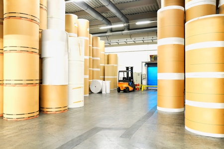 Storage of paper rolls in a large print shop Stock Photo