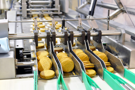 conveyor belt with biscuits in a food factory - machinery equipment Stock Photo - 93327899