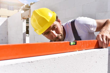 craftsmen at home construction - bricklayers working in work clothes Stock Photo