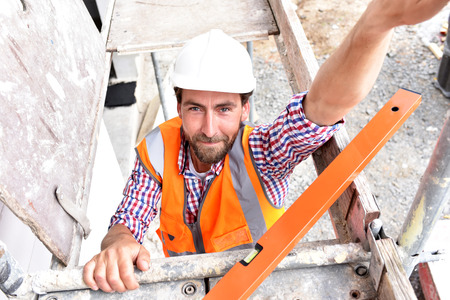 portrait of smiling construction manager  architect on site during the construction of a house