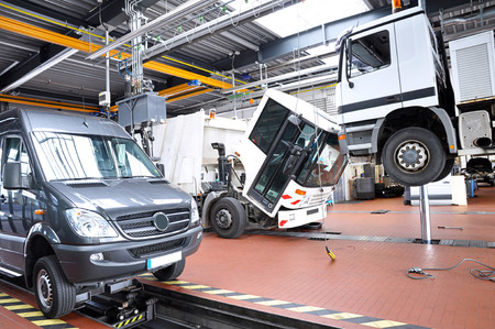 vehicles in a garage - repair and inspection of cars on a lifting platform Stock fotó