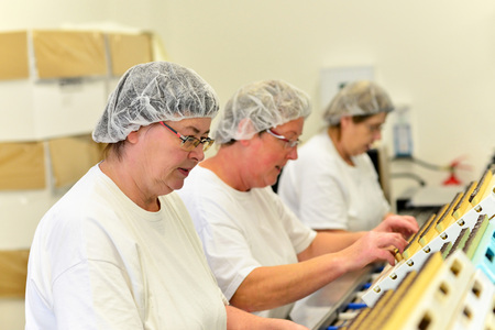 Production of pralines in a factory for the food industry Stock Photo