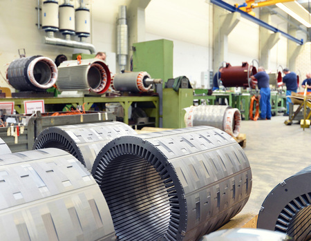 manufacture of big electronic motors in an industrial company - equipment and interior of the production halls Reklamní fotografie - 105744780