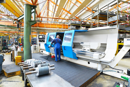 large modern cnc machine for the production of shafts for industrial electric motors in the company