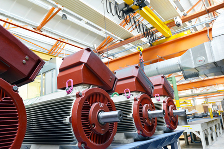 manufacture of big electronic motors in an industrial company - equipment and interior of the production halls Reklamní fotografie - 105744791