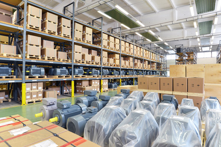 warehouses with shelves full of goods in an industrial company - storage of produced goods for dispatch to the customer Archivio Fotografico - 105744900