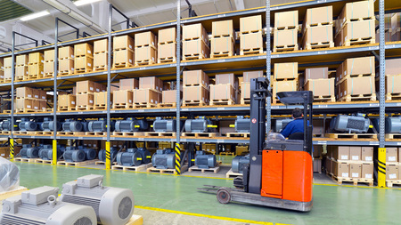 warehouses with shelves full of goods in an industrial company - storage of produced goods for dispatch to the customer Reklamní fotografie - 105744902