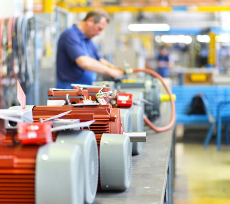 manufacture of modern electric motors in an industrial company - construction and assembly workers