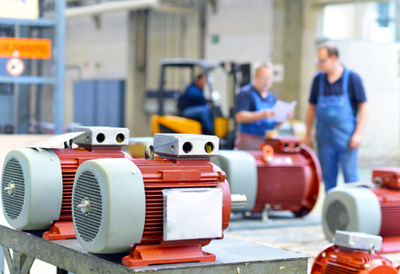 Workers in a factory assemble electric motors Stock Photo