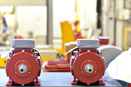 mechanical engineering: closeup of electric motors in production in a modern factory Archivio Fotografico - 105744910