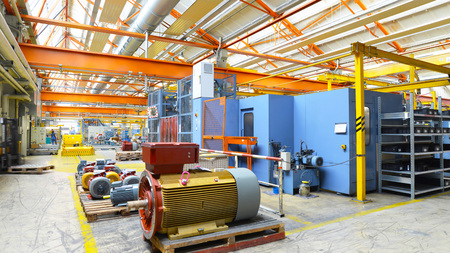 manufacture of big electronic motors in an industrial company - equipment and interior of the production halls Archivio Fotografico - 105745048