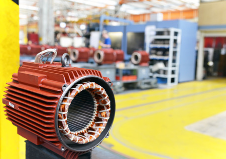 mechanical engineering: closeup of electric motors in production in a modern factory
